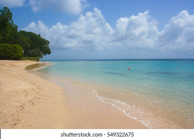 Tropical beach with clear sea and yellow sand