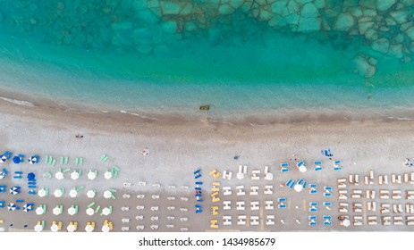 Tropical beach with colorful umbrellas - Top down aerial view - Shutterstock ID 1434985679