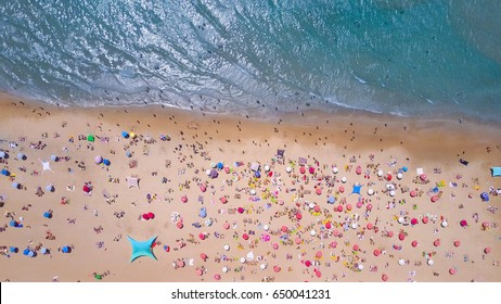 Tropical beach with colorful umbrellas - Top down aerial view