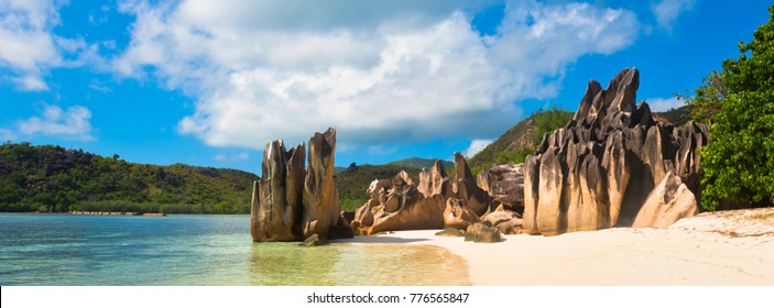 Tropical beach at Curieuse island Seychelles. Long wide banner