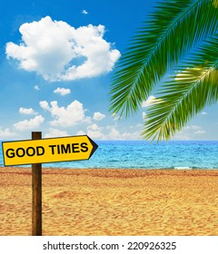 Tropical beach and direction board saying GOOD TIMES