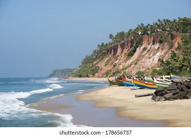 Tropical beach with fishing boats near Varkala, Kerala, India.