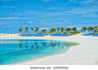 Tropical beach in Great Stirrup Cay, Bahamas. Sea shore, white sand, palm trees on blue sky. Summer vacation, recreation, resort. Paradise, peace, romance. Travel, traveling, wanderlust