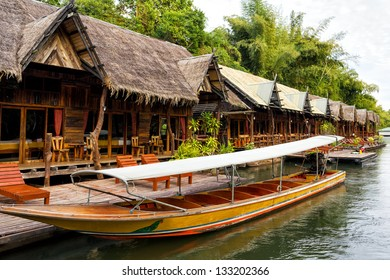 Tropical beach houses on the River Kwai in Thailand