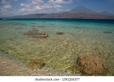 tropical beach landscape with clear blue sea and sky, sea channel between java en Bali view at vulcano Gunung Raung