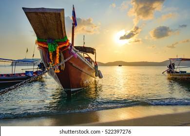 Tropical beach, long tail boats,golden sunset, gulf of Thailand,Koh Samui, Thailand
