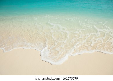 Tropical beach. Ocean wave background. White sand and crystal-blue sea. Ocean water nature, beach relax. Summer sea vacation. Maldives islands wave background