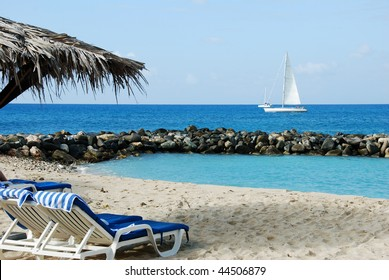 Tropical beach on St Maarten with sailboat