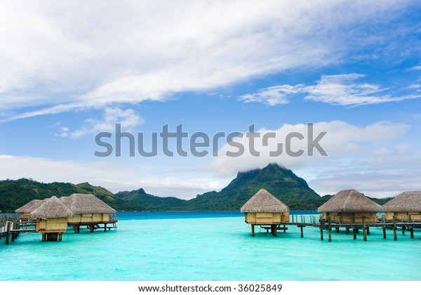 Tropical Beach Over Water Bungalow Vacation Stock Photo