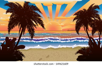 Tropical beach with palm trees at sunset or sunrise time.
