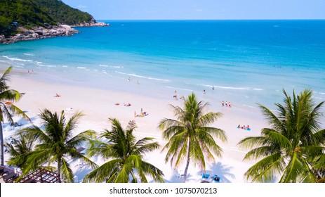 Tropical beach with  people enjoy summer time at sandy coast line of koh Phangan island,Haad Rin area,Thailand