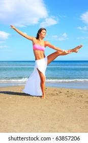 tropical beach: perfect girl meditating on a tropical beach. Copy space