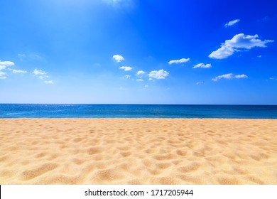 Tropical beach at Phuket Thailand. Yellow warm sand and summer sea with sky and free space