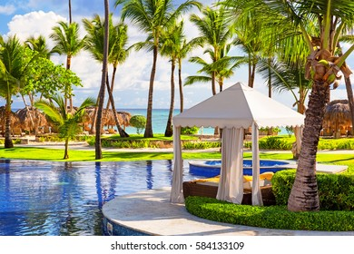 Tropical beach resort with umbrellas and lounge chairs in Punta Cana, Dominican Republic