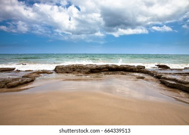 Tropical beach in with rolling waves