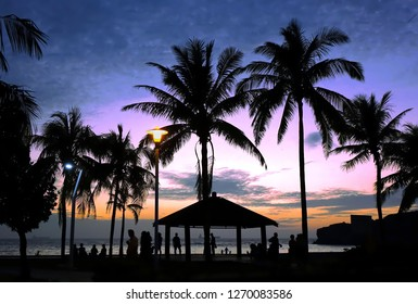Tropical beach scene with palm trees at dusk with people as silhouettes