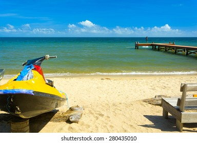 Tropical beach scene with personal water craft
