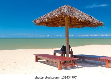Tropical beach scenery with parasol  in Thailand