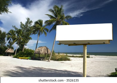 Tropical beach setting with a place to eat - included is a white billboard for you to place text or an advertisement - maybe for a travel ad?