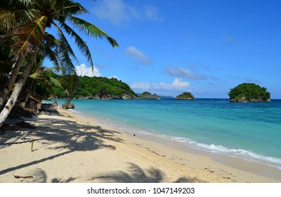 Tropical beach in southeast asia, beautiful view of the beach, palms, white sand, azure ocean and small islands, Philippines, Boracay, Ilig Iligan Beach