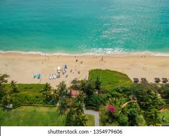 Tropical beach with sun loungers in, Sanya, China. Hainan Island, the city of Sanya, a bird's eye view of the island.