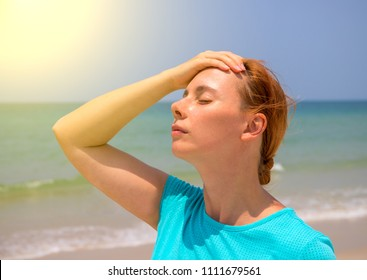 Tropical beach sun threat for health. Woman on hot beach with sunstroke. Health problem on holiday. Medicine on vacation. Dangerous sun. Beach life. Sunstroke on sunny beach. Healthcare in tropics