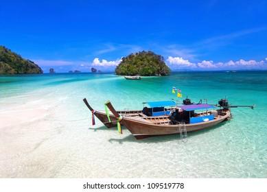 Tropical beach, traditional long tail boats, Andaman Sea, Thailand.