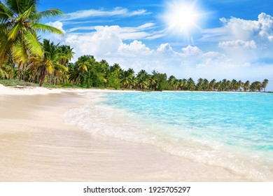 Tropical beach, turquoise sea water, ocean wave, yellow sand, green palms, sun blue sky, white clouds, beautiful seascape, summer holidays, exotic island vacation, caribbean travel, maldives landscape