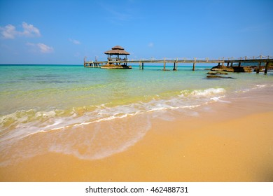 tropical beach under blue sky.