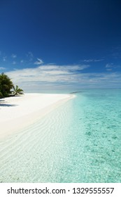 Tropical beach. White sand, blue sky and crystal sea of tropical beach. Ocean beach relax, travel to islands
