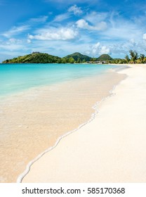 tropical beach with white sand at Tranquility Bay, Antigua island in Caribbean