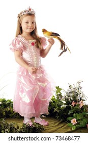 A tropical bird perched on the hand of a beautiful preschool princess.  Isolated on white.