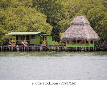 Tropical bungalow over the sea with mangrove trees in background, Caribbean, Bocas del Toro, Panama