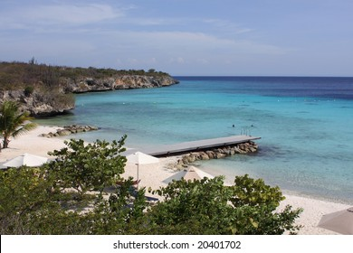 Tropical, Caribbean Beach. Playa PortoMari is a beautiful sandy bay to be found on the west coast of Curacao in the Netherlands Antilles