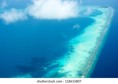 Tropical caribbean island in Indian ocean Maldives with reef