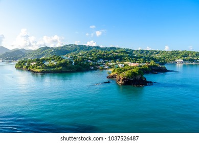Tropical coast on the Caribbean island of St. Lucia. It is a paradise destination with a white sand beach and turquoiuse sea.