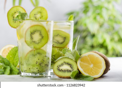 tropical cocktail with kiwi, lemon and mint on light background