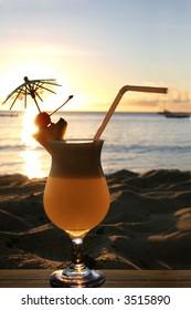tropical cocktail on beach sunset
