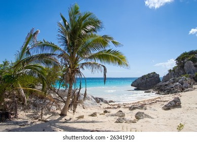 Tropical deserted beach with blue water and white sand