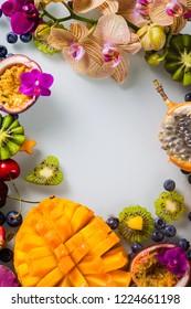 Tropical exotic fruits assorted Mango, Kiwi, Orange, Passion Fruit. Top view.