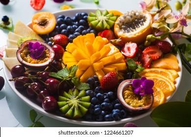 Tropical exotic fruits assorted Mango, Kiwi, Orange, Passion Fruit.