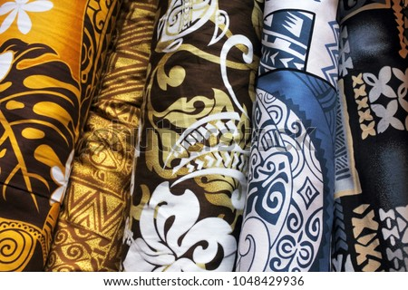 Tropical fabric rolls on display in Rarotonga market Cook Islands.Traditional fabric patterns worn by Polynesians and other South Pacific Islanders and Oceanic people.