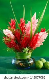 Tropical flowers arrangement in a vase