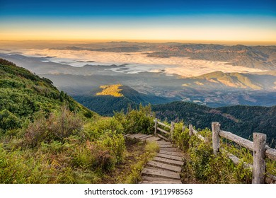 Tropical forest nature landscape view with toursits mountain range and moving cloud mist at Kew Mae Pan nature trail, Doi Inthanon, Chiang Mai Thailand