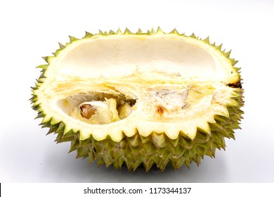 Tropical fruit durian half cut on white background. Tasty fruit with awfull smell. Exotic fruit durian half cut with flesh and seed. Thailand delicatessen. Spiky peel and sweet flesh of tropical fruit