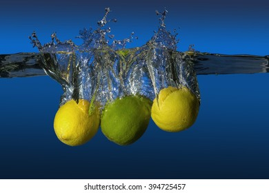 tropical fruit limes and lemons dropped in water