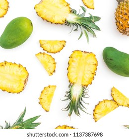 Tropical fruit pattern of pineapple and mango fruits on white background. Flat lay, top view. Food concept.