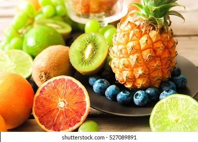 tropical fruit, pineapple, kiwi, lime, red, orange and blueberries