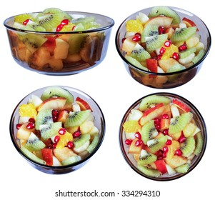 Tropical fruit salad, a bowl of dark glass, isolate on a white background in various angles.