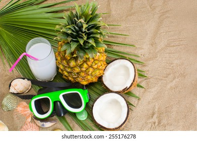 tropical fruit and snorkel on beach